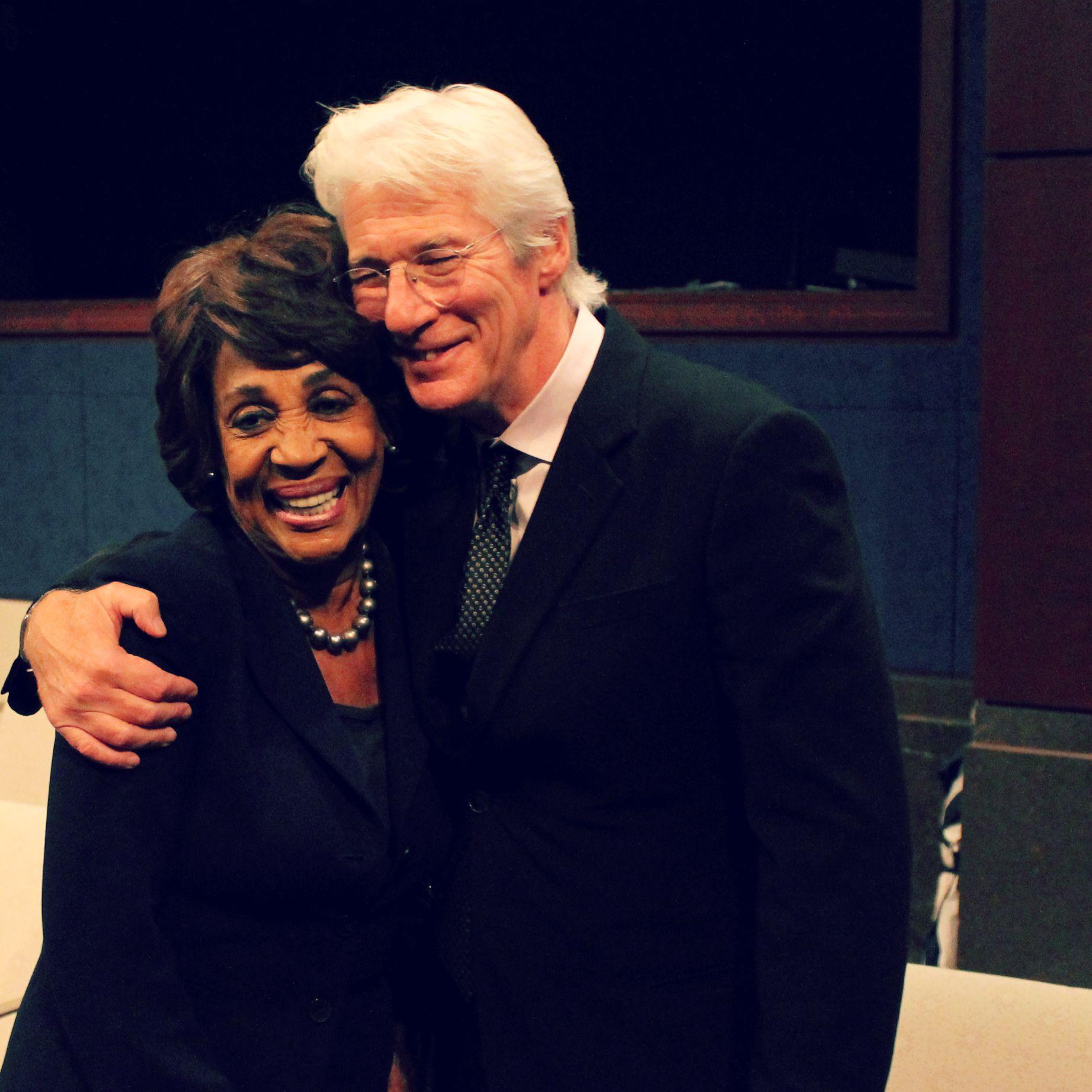 Congresswoman Waters hugs Richard Gere